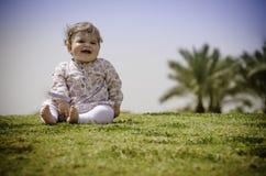 Baby girl on grass Stock Photos