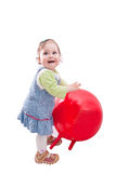 Baby girl and great red ball. Little girl playing with red ball, isolated on white Royalty Free Stock Images