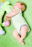 Baby girl in green stock photo