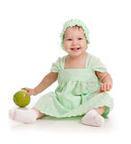 Baby girl with green apple (healthy food). Baby girl with green apple Royalty Free Stock Images