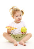 Baby girl with green apple and pizza Royalty Free Stock Photos