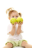Baby girl with green apples Royalty Free Stock Photo