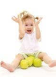Baby girl with green apples Royalty Free Stock Images