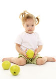 Baby girl with green apples Stock Photo