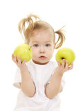 Baby girl with green apples Stock Image