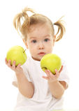 Baby girl with green apples Stock Photography
