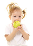Baby girl with green apples Stock Images