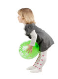 Baby girl with a green balloon Stock Photos