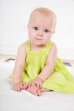 Baby girl in green dress Royalty Free Stock Image