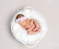 Baby girl with a hairband sleeping naked, topshot Stock Photo