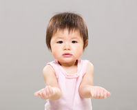 Baby girl with hand gesture showing nothing Stock Photo