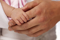 Baby Girl Hand Holding Rough Finger of Dad Royalty Free Stock Photos