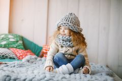 Baby girl in knitted hat and scarf royalty free stock images