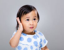 Baby girl hand touch ear Stock Photos
