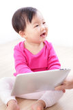 Baby girl happy play tablet PC Royalty Free Stock Photography