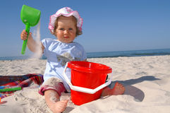 Baby girl and hat. Baby girl on the beach stock images
