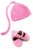 Baby girl hat. Pink knitted newborn baby girl elf hat and matching polka dot shoes royalty free stock images
