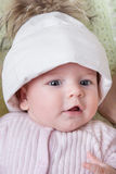 Baby girl in a hat Stock Photos