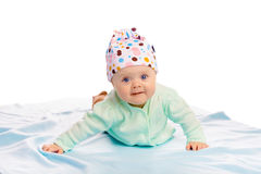 Baby girl in a hat. Studio. Charming baby girl in a hat. Studio stock photos