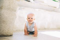 Little baby child outdoors in a european town. royalty free stock photo