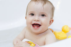 Baby girl having big bath Stock Photo