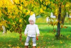 Baby girl having fun in fall park Royalty Free Stock Photos