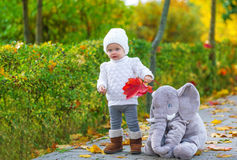 Baby girl having fun in fall park Royalty Free Stock Photo