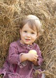 Baby girl in the haystack Royalty Free Stock Image