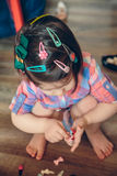 Baby girl head with a lot of hair clips Royalty Free Stock Photos