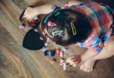 Baby girl head with a lot of hair clips Royalty Free Stock Images