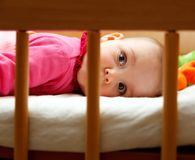 Baby girl in her bed Royalty Free Stock Images