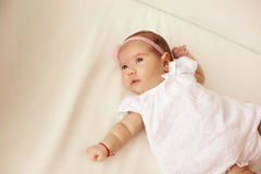 Baby girl in her bed Stock Photography