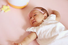 Baby girl in her bed Stock Photos
