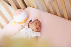 Baby girl in her bed Stock Photo