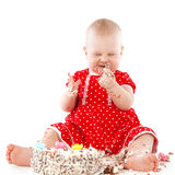 Baby girl and her birthday cake. Royalty Free Stock Photography