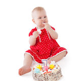 Baby girl and her birthday cake. Royalty Free Stock Photo