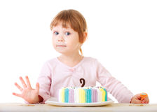 Baby girl and her birthday cake Stock Photography