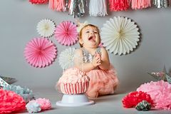 Baby girl and her birthday cake, studio royalty free stock photo