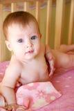 Baby Girl in her Crib Stock Photos