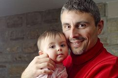 Baby Girl with her Father Stock Photos