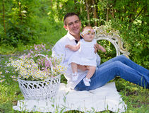 Baby girl and her father outdoors portrait royalty free stock photos