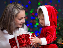 Baby girl and her mother holding gift box Stock Image