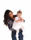 Baby girl with her mother. Royalty Free Stock Image