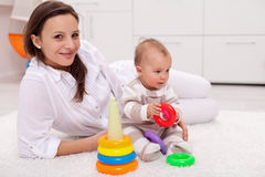 Baby girl and her mother playing Stock Photography