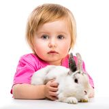 Baby girl  with her small rabbits Stock Photo