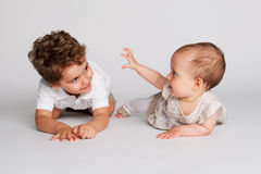Baby Girl with Her Toddler Brother. Royalty Free Stock Images