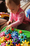 Baby girl and her toy Royalty Free Stock Photography