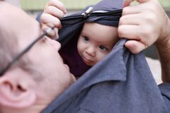 Free Baby Girl Hides And Plays With Her Father Royalty Free Stock Photography - 180040317