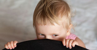 Baby girl hiding Stock Photography