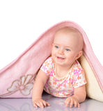 Baby girl is hiding under the blanket over white backgroun Stock Image